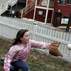Gloucester: Danielle Larabee, 9, plays catch with her dad in their front yard on Rocky Neck Wednesday afternoon.  Danielle was warming up for her upcoming softball season. This year she will be playing for the East Gloucester Vikings. Mary Muckenhoupt/Gloucester Daily Times