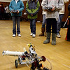 Gloucester: Kaylyn Andrews, left, Livie Casey, center, and Lindsey Parrish, right, all fifth grade students at West Parish Elementary School, drive remote control robots during the 2nd annual robotics event at the Fuller School yesterday. Fifth graders toured through three rooms of hands-on activities and learned about different types of robots and physics. Photo by Kate Glass/Gloucester Daily Times Monday, March 30, 2009
