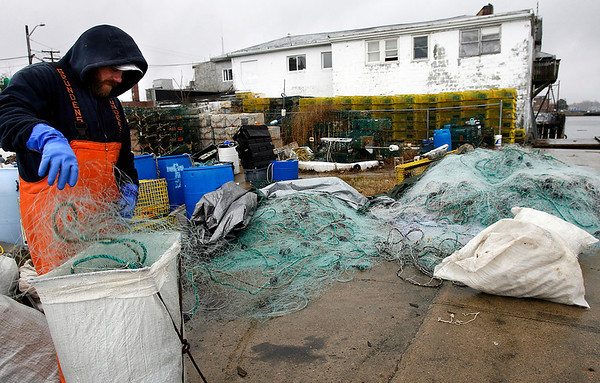 Gloucester: Randy Mustake packs up gillnets to be repaired at the end of the commerial fishing season in the area outside Gloucester Harbor. The area is closed during April and May, sending many local fishermen south to New Bedford or Cape Cod. Photo by Kate Glass/Gloucester Daily Times Monday, March 30, 2009