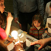 Gloucester: Sydnie Bouchie, 3, and her brother Andrew, 6, look at the energy efficiency booth at the Science Fair held at West Parish Elementary School Friday evening.  The two learned that energy efficiency light bulbs are just as bright as regular light bulbs but use much less energy. Mary Muckenhoupt/Gloucester Daily Times