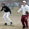 Gloucester: Jimmy Nicoloisi, left, with first baseman Trevor Curley looks to see if he can run to second during baseball practice at Nate Ross Field Thursday afternoon. Mary Muckenhoupt/Gloucester Daily Times