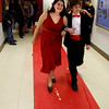 "Rockport: Jenny Sonia and Jeff Cloak, both sixth graders at Rockport Middle School, stroll down the red carpet as their classmates look on during ""Red Carpet Day"" on Friday. Photo by Kate Glass/Gloucester Daily Times Friday, March 13, 2009"