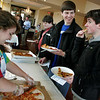 Gloucester: Andrew Ryan, right, and Chris Peritore, both juniors at Gloucester High take some pizza samples from Katina Tibbetts at the Gloucester High School Interact Club annual Pizza Taste Off at Cruiseport last night.  There were 16 local businesses who were in competiotion for Cape Ann's favorite pizza. Profits benefited Relay for Life. Mary Muckenhoupt/Gloucester Daily Times