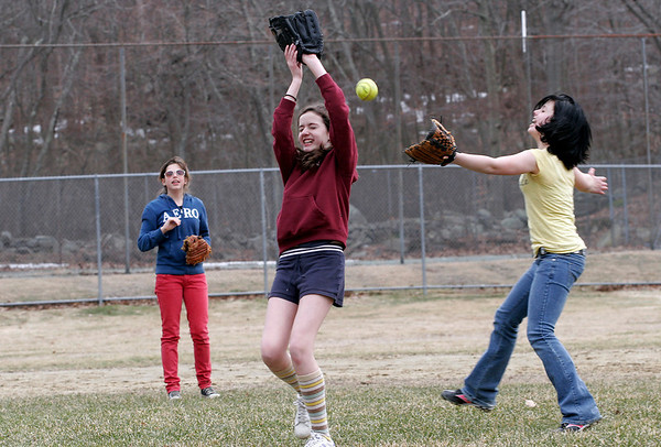 Rockport: Meredith Cooney, left, Aidan Wright, center, and Hannah Rowe, right, all 12, try to catch a pop fly while playing softball at the Story Street Playground on Wednesday afternoon. The girls were just playing for fun. Photo by Kate Glass/Gloucester Daily Times Wednesday, March 18, 2009