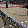 Gloucester: Brett Davis reaches for a shot as he plays doubles with Kyle Smith during the first day of tennis practice yesterday. Photo by Kate Glass/Gloucester Daily Times Monday, March 16, 2009