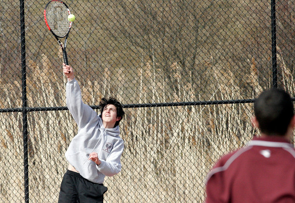 Gloucester: Brian Hand serves to Brett Davis during the first day of tennis practice yesterday. Photo by Kate Glass/Gloucester Daily Times Monday, March 16, 2009