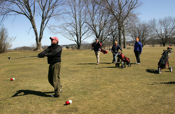 Essex: Arthur Burt hits the ball down the fairway while playing golf with his friends at the Cape Ann Golf Course Wednesday afternoon.  Also pictured, from right, Bruce Andersen, Don Sawyer and Dennis Montgomery. Mary Muckenhoupt/Gloucester Daily Times