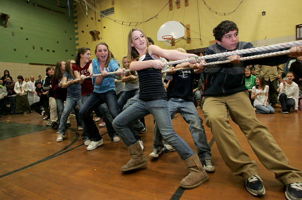 Gloucester:  The seventh graders at O'Maley Middle School, including Laura Harrington and Zack Zappa, front, pull with all their might while participating in tug of war with the sixth graders during the March Madness celebrations Wednesday afternoon.  The seventh graders won this round but quickly lost to the eight graders during the next round. Mary Muckenhoupt/Gloucester Daily Times