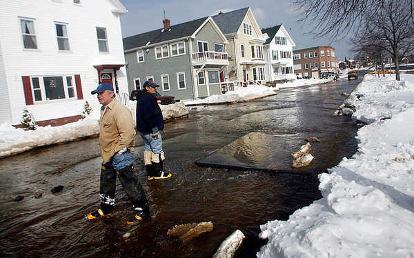 Gloucester: Don Peavey, foreman of the water department, and Frank Saunders, wade through water on Western Ave. yesterday afternoon following a water main break. Photo by Kate Glass/Gloucester Daily Times Tuesday, February 3, 2009