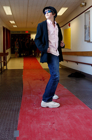 "Rockport: Logan Trupiano, a sixth grader at Rockport Middle School, mugs for photos as he strolls down the red carpet on Friday. The school held a ""red carpet day"" as part of spirit week. Photo by Kate Glass/Gloucester Daily Times Friday, March 13, 2009"