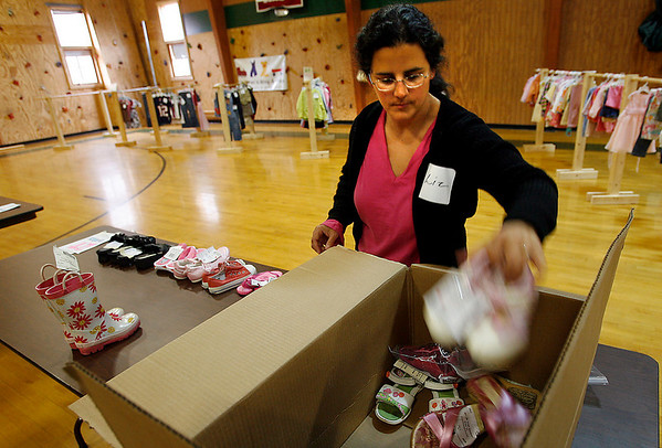 "Manchester: Liz Yanishevsky of Swampscott organizes childrens shoes at the ""Children's Drop & Shop,"" which is being held at Brookwood School. Childrens clothes and toys can be consigned at the school today and tomorrow from 10-2. People can shop Friday through Sunday from 9-5 and all items will be 50% off on Sunday. Photo by Kate Glass/Gloucester Daily Times Monday, March 16, 2009"