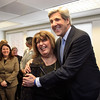 Gloucester: U.S. Senator John Kerry hugs Sefatia Romeo as he concludes his tour of the Gloucester Community Health Center Saturday afternoon.  Congressman John Tierney and senator Bruce Tarr were also on the tour of the new health facility. Mary Muckenhoupt/Gloucester Daily Times