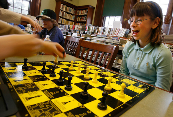 Manchester: Julia Geswell, 11, watches as Isaiah Thomas, 11, captures one of her pawns as they play chess at the Manchester-by-the-Sea Public Library on Tuesday afternoon. Sandra Stolle teaches lessons there on Tuesdays at 3:30 for children grades 4-6. Photo by Kate Glass/Gloucester Daily Times Tuesday, March 10, 2009