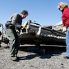 Rockport: Rockport Harbormasters Scott Story and Rosemary Lesch flip over a dock at the Old Granite Pier to prepare it for repairs yesterday afternoon. Photo by Kate Glass/Gloucester Daily Times Tuesday, March 31, 2009