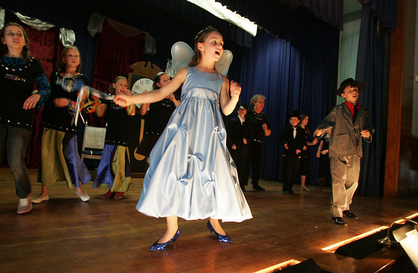 "Gloucester: Caroline Murray, playing the fairy Godmother, and her twin brother Seth Murray, playing the fairy Godfather, dance on stage during the dress rehearsal for ""Twinderella"" at East Gloucester Elementary School Tuesday afternoon. The play put on by the fifth grade class will be performed at the school Thursday and Friday at 7 p.m. and Saturday at 2 p.m. Mary Muckenhoupt/Gloucester Daily Times"