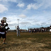 Gloucester: Gloucester's Eden Louis, left, and Shane Stephenson, center, pass the ball during the first day of lacrosse practice yesterday. Photo by Kate Glass/Gloucester Daily Times Monday, March 16, 2009