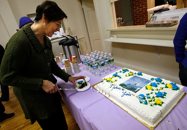 "Rockport: Louisa Casadei-Johnson cuts the cake during the First Congregational Church of Rockport's ""Town Appreciation Day"" yesterday. Members of the church set up a historical exhibit about the church, discussed plans for future renovations, and provided food for those who attended. Photo by Kate Glass/Gloucester Daily Times Sunday, March 29, 2009"