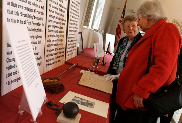 "Rockport: Virginia Stansfield, left, shows Mary Francis some of the artifacts from the First Congregational Church of Rockport during their ""Town Appreciation Day"" yesterday afternoon. Members of the church set up an exhibit on the history of the church and also discussed plans for future renovations, which will include painting the sides of the church and restoring the windows. Photo by Kate Glass/Gloucester Daily Times Sunday, March 29, 2009"