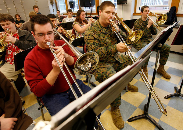 Gloucester: Chris Crabb, Mike Schmorrow, and Angelo Ingaharro rehearse with the Gloucester High School's jazz band, Docksiders, yesterday afternoon. The Docksiders are having a concert this Saturday at 7pm to raise money for their trip to Hawaii in 2010 to perform on the USS Missouri, the Polynesian Cultural Center and the Hard Rock Cafe in Honolulu. Photo by Kate Glass/Gloucester Daily Times Wednesday, March 11, 2009