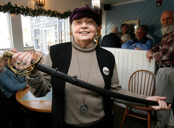 Essex: Christy Park of Gloucester displays a Cavlary Sword from the Civil War, which was appraised at $1,000 during Essex Antique night at Periwinkles. Photo by Kate Glass/Gloucester Daily Times Thursday, March 19, 2009