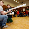 Gloucester: CJ Mustone, a senior at Gloucester High School, shows Michael Vaiarella, a fifth grade student at West Parish Elementary School, how to fire a T-Shirt cannon during the 2nd annual robotics event at the Fuller School yesterday. Fifth graders toured through three rooms of hands-on activities and learned about different types of robots and physics. Photo by Kate Glass/Gloucester Daily Times Monday, March 30, 2009