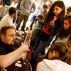 Rockport: Aoife Twomey, Maddie Ryan, Miyen Chang, and Laura Budrow watch as Erik Millett plays sitar in the lobby of the Rockport Middle School on Tuesday. Millett and Matt Pert (playing the tabla) both study ethnomusicology at Salem State College and were at the school for and educational outreach program sponsored by Rockport Music. Photo by Kate Glass/Gloucester Daily Times Tuesday, March 17, 2009