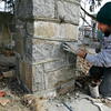 Gloucester: Luke Lombardi of Lombardi & Son Masonry repairs a stone wall on Rocky Neck with his father, Don Lombardi, left. The two say they are glad to be out working again now that it is warm and the snow has melted. Photo by Kate Glass/Gloucester Daily Times Monday, March 16, 2009