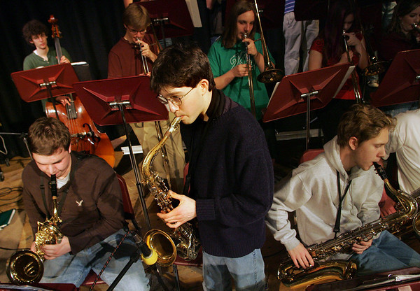 Gloucester: Alek Razdan stands up for his solo while rehearsing with the Rockport High School stage band for the Jammin' concert at Rockport High School Thursday afternoon.  The concert was held Thursday night. Mary Muckenhoupt/Gloucester Daily Times