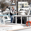Gloucester: Janet Marshall shovels snow off the Tragabigzanda at the Jodrey State Fish Pier on Tuesday afternoon. The boat is named after the original name that John Smith gave to Cape Ann when he arrived in 1614. Photo by Kate Glass/Gloucester Daily Times Tuesday, March 10, 2009