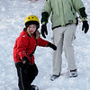 Rockport: Mark Kanegis watches as his daughter, Elise Kanegis, snowboards at Evans Field. Elise had been snowboarding three other times, but said if she were going to a mountain, she would rather ski. Photo by Kate Glass/Gloucester Daily Times Tuesday, March 3, 2009