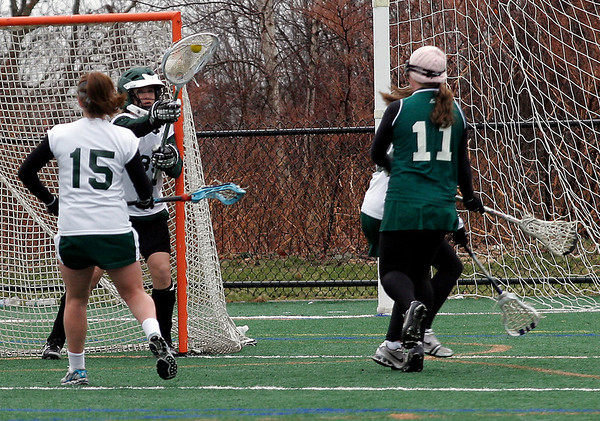 Manchester: Manchester Essex's Amelia Cohen blocks a shot during their game against Pentucket at Coach Ed Field Field yesterday afternoon. The Hornets won 12-11. Photo by Kate Glass/Gloucester Daily Times Monday, March 30, 2009