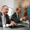 Essex: Roger Pheulpin of Joshua's Corner Antiques and Michael March of Blackwood March Auctions appraise items during Essex Antique night at Periwinkles. Photo by Kate Glass/Gloucester Daily Times Thursday, March 19, 2009