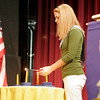 Gloucester: Jessica Olson lights a candle after reading about service during the Annual National Honor Society Induction Ceremony at Gloucester High School last night. Olson serves as the NHS Librarian. Photo by Kate Glass/Gloucester Daily Times Tuesday, March 31, 2009