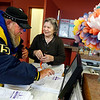 Gloucester: Peg Shea helps Captain Willy use the computer to check in at the Rose Baker Senior Center yesterday afternoon. Employees like Shea, who work for the center through Project Able, will be keeping the center running after several employees took the city's retirement incentive due to budget cuts. Photo by Kate Glass/Gloucester Daily Times Monday, March 30, 2009