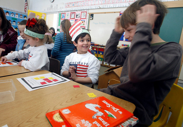 "Manchester: Max Vinciguerra, left, smiles as he beats Winston Feuerbach, right, at ""Cat in the Hat Tic-Tac_Toe"" at Manchester Memorial School yesterday afternoon. Sixth graders visited kindergarten classrooms to play Dr. Seuss inspired games to commemorate his birthday, which was March 2nd. Photo by Kate Glass/Gloucester Daily Times Tuesday, February 3, 2009"