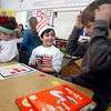 """Manchester: Max Vinciguerra, left, smiles as he beats Winston Feuerbach, right, at """"Cat in the Hat Tic-Tac_Toe"""" at Manchester Memorial School yesterday afternoon. Sixth graders visited kindergarten classrooms to play Dr. Seuss inspired games to commemorate his birthday, which was March 2nd. Photo by Kate Glass/Gloucester Daily Times Tuesday, February 3, 2009"""