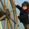 Gloucester: Tess Fein, 3, spins the captain's wheel at the Cape Ann Museum Thursday morning.  Fein, who llives in Beverly, came to the museum with her mom and some friends for something fun to do in Gloucester. Mary Muckenhoupt/Gloucester Daily Times