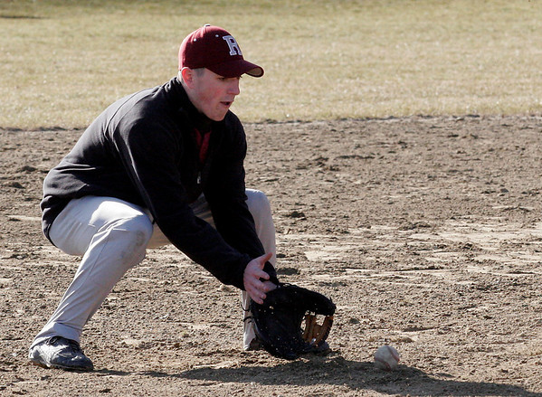 Rockport: Pat Frithsen fields a ground ball during the Rockport baseball team's first practice outside yesterday. Frithsen is one of the co-captains of the varsity team. Photo by Kate Glass/Gloucester Daily Times Tuesday, March 17, 2009