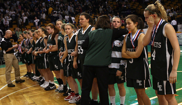 Boston: Manchester Essex Athletic Director Kelly Porcaro hugs members of the girls basketball team as she and Principal James Lee present them with medals following their 50-40 loss to Cohasset in the MIAA Division 4 State Finals at the TDGarden in Boston yesterday. Photo by Kate Glass/Gloucester Daily Times