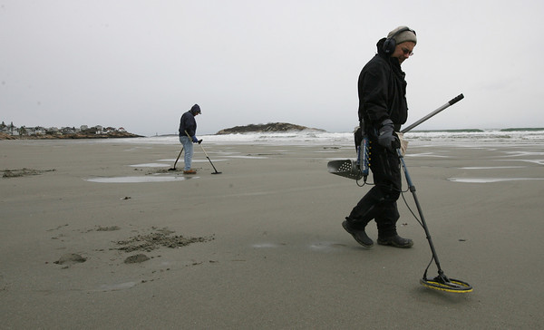 """Gloucester: Michael and """"Boston Bob"""" search Good Harbor Beach for rings and coins on Wednesday afternoon. The two said there were about 18 people with metal detectors at the beach on Sunday and everyone found gold because of all the sand washed away by recent storms. They also remove soda tabs and other metallic trash they discover from the beach to prevent injury. Photo by Kate Glass/Gloucester Daily Times"""