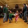Gloucester: Neville Clancy and Olivia Royle dance through the lines during a Celtic Music Celebration at City Hall on Sunday. The event, which featured music from Easter Snow, was a fundraiser for the restoration of city hall. Photo by Kate Glass/Gloucester Daily Times