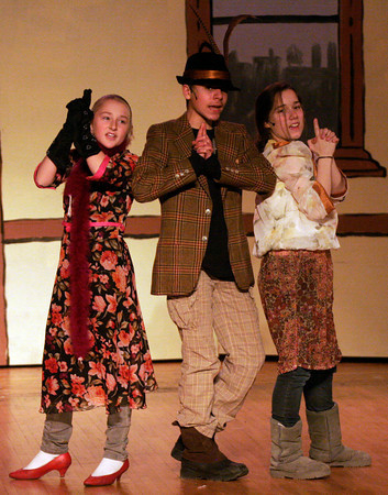 "Gloucester: Tess Benson, Zach DaSilva, and Madison Smith mimic the ""Charlie's Angels"" pose as they come up with a plan to get reward money for Annie in the O'Maley Middle School performance of ""Annie Junior."" The show, which features seventy students in the cast and crew, will be performed Friday, March 5 & 12 at 7pm and Saturday, March 6 & 13 at 1pm. Tickets are $5 for students and seniors and $7 for adults. Photo by Kate Glass/Gloucester Daily Times"