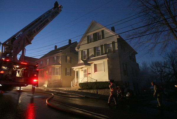 Gloucester: Gloucester Firefighters extinguish a blaze at 13 Commonwealth Ave. last night. Photo by Kate Glass/Gloucester Daily Times
