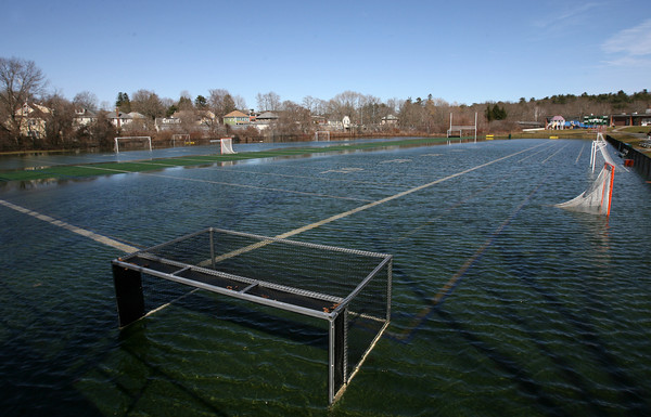 Manchester: Coach Ed Field Field was still covered in water yesterday afternoon. Photo by Kate Glass/Gloucester Daily Times