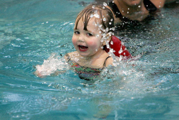 Gloucester: Mallory Greeke, 3, splashes around during her private swim lesson with Erica Quince at the Cape Ann YMCA Thursday afternoon. Mary Muckenhoupt/Gloucester Daily Times