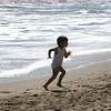 Manchetser: Kaleb Abraham, 4, runs back to the beach blanket where his mother and baby brother were sitting while enjoyin gthe warm weather at Singing Beach Wednesday afternoon. Mary Muckenhoupt/Gloucester Daily Times