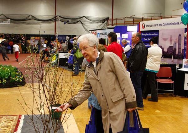 Gloucester: Helen Lang checks out on the the bushes for sale at the fifth annual Home and Garden Show put on by the Cape Ann Chamber of Commerce Saturday afternoon. Mary Muckenhoupt/Gloucester Daily Times