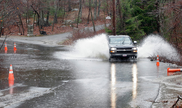 Gloucester: A truck is forced to drive on the wrong side of Hesperus Avenue to navigate through a flooded section of the road yesterday afternoon as rain returns to the area. Photo by Kate Glass/Gloucester Daily Times