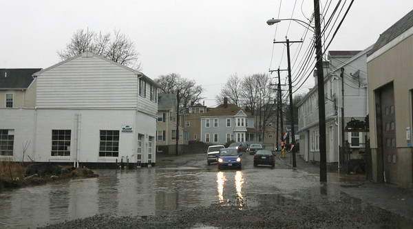 Gloucester: Cars navigate through a flooded section of Maplewood Ave yesterday afternoon. Photo by Kate Glass/Gloucester Daily Times
