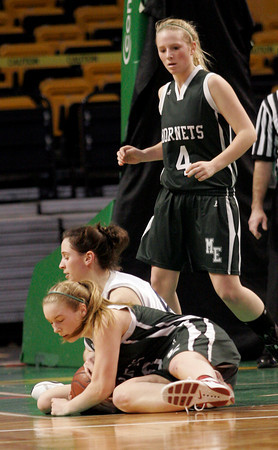 Boston: Manchester Essex's Abbi Biggar steals the ball from Cohasset's Carli Haggerty as teammate Julia Martz looks on at the MIAA Division 4 State Finals at the TDGarden in Boston yesterday. Photo by Kate Glass/Gloucester Daily Times